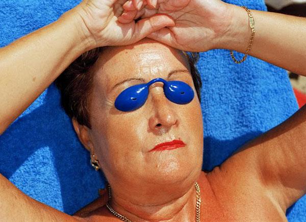 600-martin-parr-common-sense-woman-sunbathing-spain-1997
