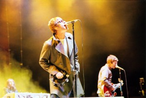 Oasis brothers Noel and Liam Gallagher performing in 2005 (Credit/source: [http://www.flickr.com/photos/freschwill/44256675/ Will Fresch])